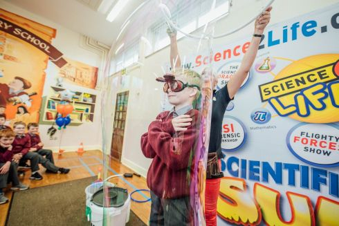 BURST YOUR BUBBLE: John Beary steps inside a bubble as Scientific Sue launched the Tipperary Festival of Science at Monastery Primary School in Tipperary Town. The Tipperary Festival of Science (TFS) will take place in schools, libraries and arts centres throughout the county from November 10th-17th as part of national Science Week. The festival, which will attract over 4,000 people across the week, will feature an array of STEM (Science, Technology, Engineering, Mathematics) based activities for all the family that will engage children and adults in the wonderful world of science. Photograph: Brian Arthur
