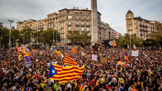 Protesters march along Passeig de Gracia avenue in Barcelona waving pro-independence Catalan Estelada flags. Photograph: Angel Garcia/Bloomberg.