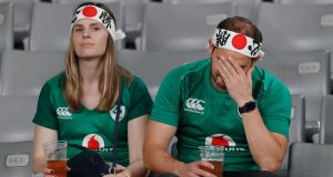 Ireland fans sit dejected in the stand after the Rugby World Cup quarter-final loss to New Zealand. Photo: Issei Kato/Reuters