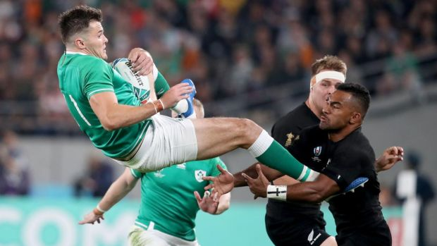 Ireland's Jacob Stockdale catches the ball ahead of New Zealand's Sevu Reece during the Rugby World Cup quarter-final in Tokyo. Photograph: Dan Sheridan/Inpho