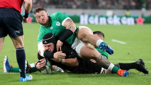 New Zealand's Matt Todd scores a try despite the efforts of Ireland's Andrew Porter and Jonathan Sexton. Photograph: Billy Stickland/Inpho