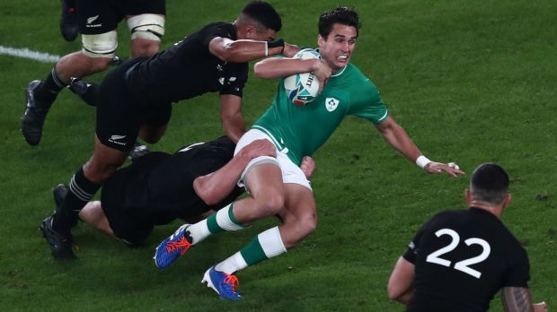 Ireland's Joey Carbery is tackled during the Rugby World Cup quarter-final against New Zealand. Photograph: Behrouz Mehri/AFP via Getty Images