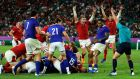 Jaco Peyper awards Ross Moriarty's try. Photograph:  Christophe Ena/AP