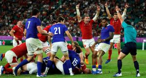 Wales fight back from the brink to deny 14-man France