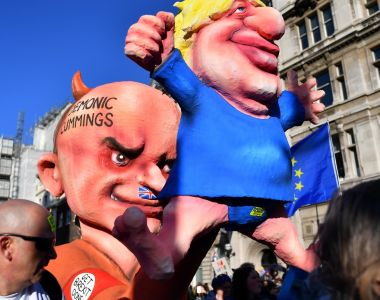 Figures depicting Britain's prime minister Boris Johnson (right) and his special advisor Dominic Cummings are displayed during a pro-EU demonstration.