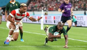 Makazole Mapimpi dives to score South Africa's third try in their win ovre Japan. Photograph: Hannah Peters/Getty