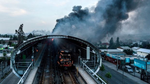 A burned metro station after protests in Santiago. Photograph: Javier Torres/Aton Chile/AFP via Getty