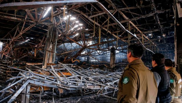A burned out supermarket in Valparaíso, Chile. Photograph: Javier Torres/AFP via Getty