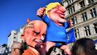 Figures depicting British  prime minister Boris Johnson  and his special adviser Dominic Cummings  during a pro-EU demonstration in London
