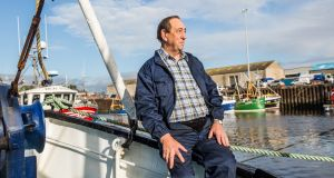 Leslie Garvan  on board one of his two fishing boats in  Kilkeel harbor in Northern Ireland. Photograph: James Forde for The Irish Times