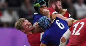 France's lock Sebastien Vahaamahina (black cap) elbows Wales' flanker Aaron Wainwright and earns a red card in the World Cup quarter-final at the Oita Stadium in Oita. Photograph: Charly Triballeau/AFP