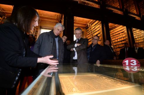 CUBAN VISIT: Miguel Diaz-Canel Bermudez (second left), President of the Republic of Cuba, viewing one of the 12 remaining copies of the Proclamation of the Irish Republic in the Long Room at Trinity College Dublin, with Provost Patrick Prendergast. Photograph: Alan Betson