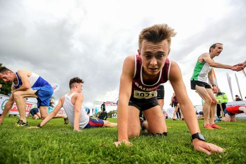 WELL GROUNDED: Eanna Folan, of Galway City Harriers AC, takes a breather after the senior men's race at the Autumn Open International Cross Country Festival, at the National Sports Campus, Deanestown, Co Dublin. Photograph: Bryan Keane/Inpho