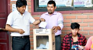 Bolivian president Evo Morales  casts his vote at a polling station on Sunday. Photograph: Jorge Abrego/EPA
