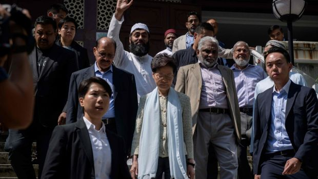 Hong Kong's chief executive Carrie Lam (centre) exits the Kowloon Mosque, or Kowloon Masjid and Islamic Centre, in the Tsim Sha Tsui district in Hong Kong on October 21st, 2019. Photograph: Ed Jones/AFP/Getty Images