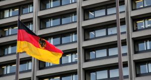 A German flag flies in front of the Bundesbank headquarters in Frankfurt, Germany . Photographer: Ralph Orlowski/Bloomberg