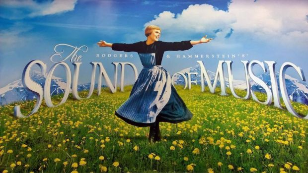 Julie Andrews depicted in the original poster for The Sound of Music (1965)