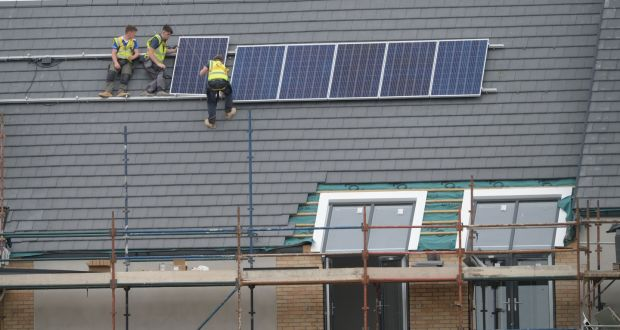 Installation of  energy efficient solar panels. Photograph: Alan Betson / The Irish Times
