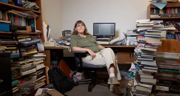Elizabeth Anderson in her office at the University of Michigan: 'There is a profound suspicion of anyone who is poor, and a consequent raising to the highest priority imposing incredibly humiliating, harsh conditions on access to welfare benefits.' Photograph: © John D and Catherine T MacArthur Foundation – used with permission