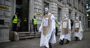 Climate change activists in London. Photograph: Peter Summers/Getty