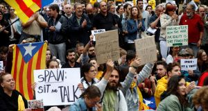 A sit-down protest outside Catalan government headquarters after a weekend of unrest. Photograph: Toni Albir