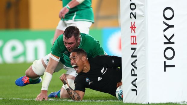 Aaron Smith celebrates his first try as Peter O' Mahony dives in. Photo: Stu Forster/Getty Images