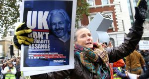 Demonstrators outside Westminster magistrates court in London: Julian Assange appeared frail and disorientated as he stood in the dock.  Photograph: Isabel Infantes/AFP