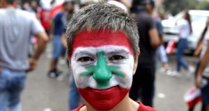 Lebanese woman with a national flag painted on her face taking part in a rally in Beirut on October 20th on the fourth day of demonstrations against tax increases and corruption. Photograph: Patrick Baz/AFP