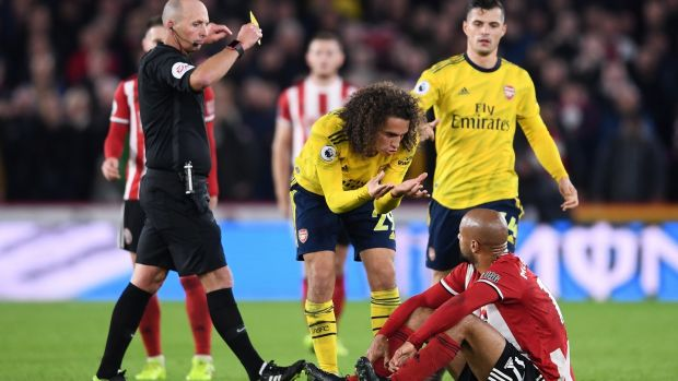 Matteo Guendouzi speaks with David McGoldrick. Photo: Laurence Griffiths/Getty Images