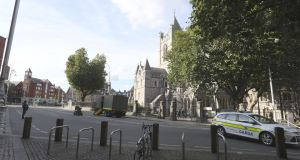 Gardaí and the Defence Forces' Explosive Ordnance Disposal unit seal off the area around Christchurch cathedral in Dublin city centre on Monday. Photograph: Collins