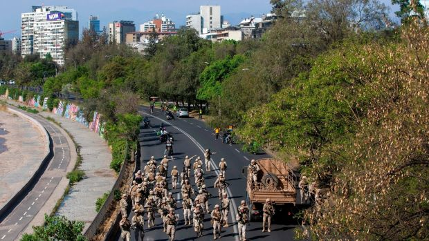 Chilean soldiers are deployed during protests in Santiago. Photograph: Claudio Reyes/ AFP/Getty