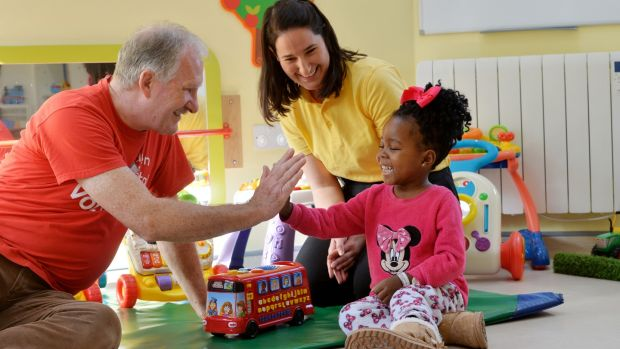 Volunteer Ainnle O'Neill and play specialist Emma Fratangelo with Amisa Tambwe (4) from Cavan. Photograph: Alan Betson