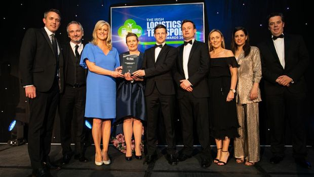 Conor Morgan, Head of Transport & Logistics, AIB Corporate Banking presents the Overall Logistics & Transport Excellence Award to the Kuehne + Nagel team.