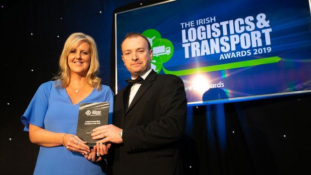 Conor Morgan, Head of Transport & Logistics, AIB Corporate Banking presents the Transport Company of the Year award to the NVD team.