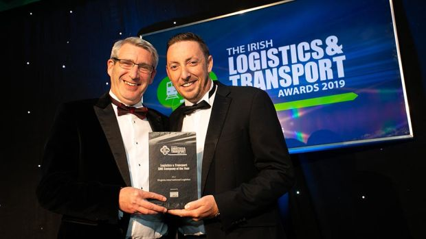 John Casey, Head of Asset Management, Rohan Holdings presents the Freight Forwarding Company of the Year award to Pamela Quinn, Kuehne + Nagel.
