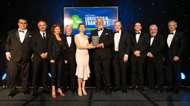 Seamus Kavanagh, Awards Judge presents the Passenger Transport SME Company of the Year award to the Swords Express team.