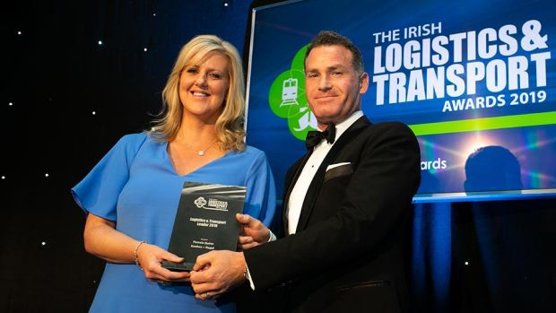 Richard Archer, General Manager, Samskip presents the Logistics & Transport Team of the Year award to the School of Management, TU Dublin team.