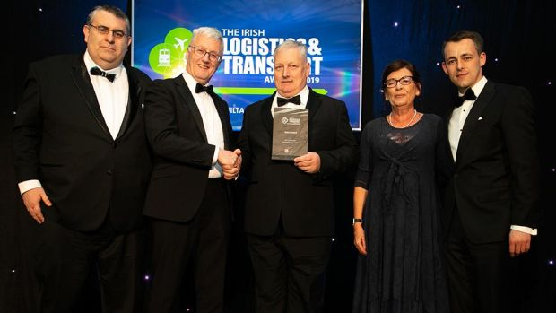 Liam Duggan, Director, RSA presents the Safety Award to the ATC Computer Transport & Logistics team.