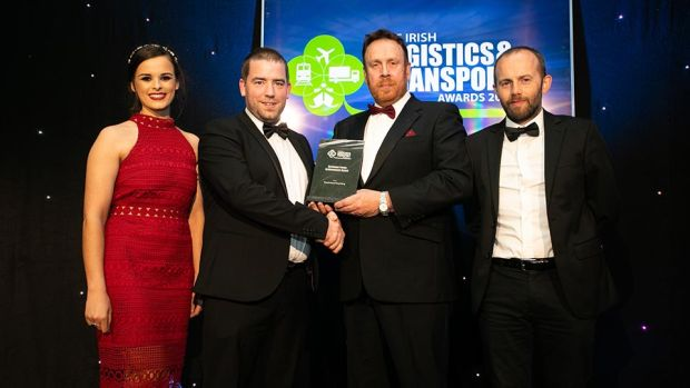 Declan Allen, Judging Co-ordinator presents the Customer Focus Achievement Award to the Greyhound Recycling team.