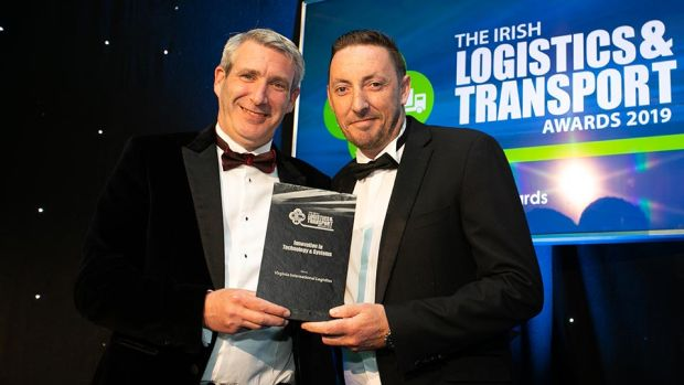 Ciarán Miller, Managing Director, Linde Material Handling Ireland presents the Innovation in Technology & Systems award to Gerry Murphy, Virginia International Logistics.