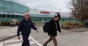 Staff leaving at Molex plant in Shannon on Tuesday. Its impending closure was 'a global decision made on the basis that 75% of the product they manufacture in the Shannon plant is at end of life'. Photograph: Eamon Ward