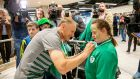 Joe Schmidt signs Jennifer Malone's shirt  as the Irish rugby team arrive back into Dublin Airport. Photograph: Morgan Treacy/Inpho