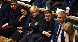 British prime minister Boris Johnson with frontbench colleagues  during Tuesday night's  debate and vote on the Brexit Withdrawal Agreement Bill in the House of Commons in London.