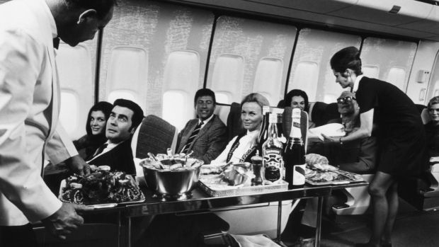 In-flight snacks were once provided for free, perhaps to distract us from our surroundings. Photograph: Fox Photos/Getty Images