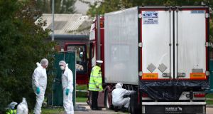ESSEX TRUCK: Police at the scene where 39 bodies were discovered in a lorry container, in Grays, Essex, Britain. Photograph: Hannah McKay/Reuters