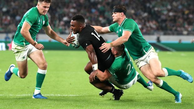 New Zealand's Sevu Reece is tackled by Jordan Larmour and Garry Ringrose during the Rugby World Cup quarter-final at the Tokyo Stadium. Photograph: Cameron Spencer/Getty Images