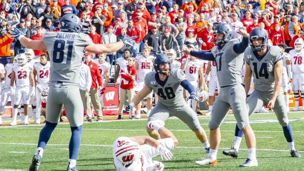 Illinois Fighting Illini place kicker James McCourt celebrates landing his winning kick with team-mates Griffin Palmer (81), Bryce Barnes (48) and Blake Hayes (14). Photograph: University of Illinois Athletics