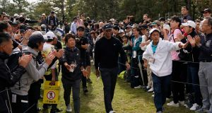 Tiger Woods walks to the eighth hole during the first round of the Zozo Championship at the Accordia Golf Narashino. Photo: Lee Jin-man/AP Photo