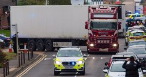 Police move the truck and trailer   from the scene in Waterglade Industrial Park in Grays to nearby Tilbury Docks to remove the bodies. Photograph:  EPA/Vickie Flores