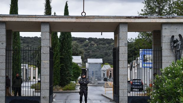 Spanish police stand outside the cemetery where the remains of Spanish dictator Francisco Franco were to be reburied. Photograph: Jeff J Mitchell/Getty Images